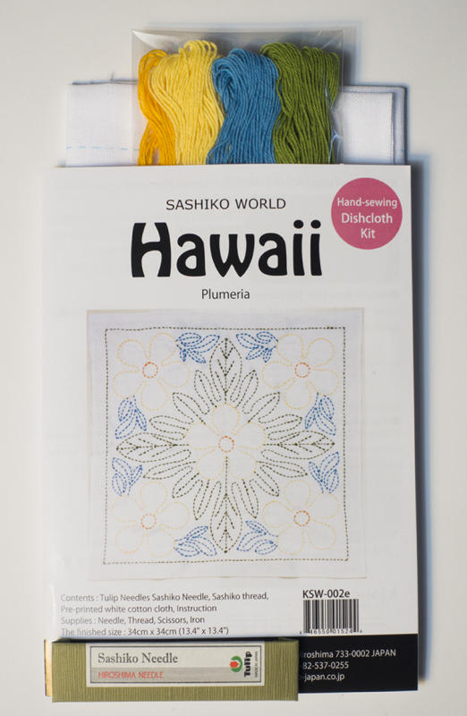 "Plumeria Sashiko Kit-  Hawaiian flora pattern on white fabric. finished size 13"" x13""  backing included. Kit includes sampler, thread and needle.Pattern washes out after stitching is finished    $20.50"