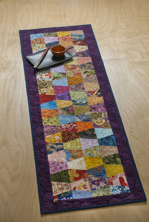 "Bright Asian pre-cut fabrics in this table runner add a colorful addition to any table. Kit includes 89 pre-cut tumblers, border, binding & pattern.  17"" x 54"" $45. Fabrics in kits are subject to change   : Kits : Easy Piecing :: Sashiko Supplies:: Shweshwe Fabric:: Japanese Fabrics"