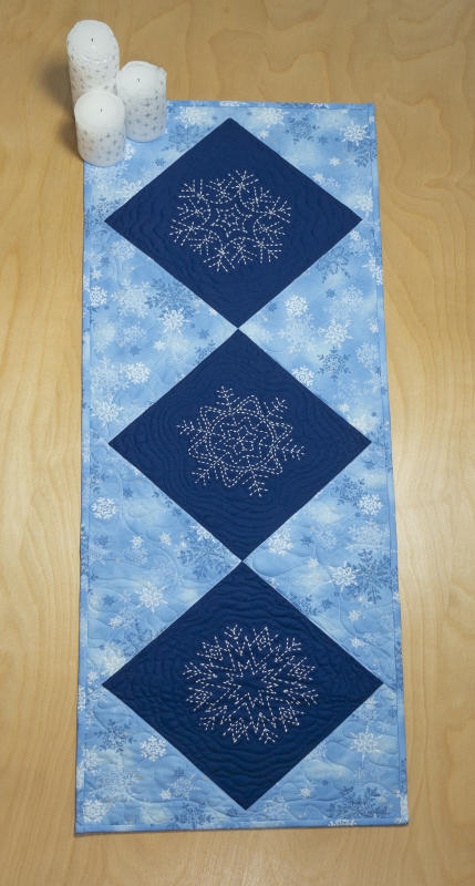 "Sashiko Snowflake table runner kit. Kit includes 3 pre-printed patterns and 1/2 yard of fabric for background and binding.  Backing and one skein of thread Not included. We have the thread. Pattern included. 14""x 39"" $30 : New Sashiko Snowflakes : Easy Piecing: Sashiko Supplies: Shweshwe Fabric: Japanese Fabrics"